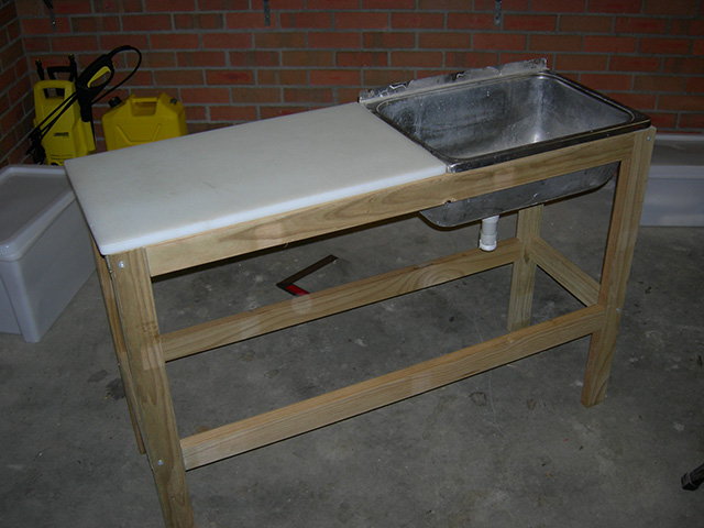 Diy portable fish cleaning station diy do it your self for Homemade fish cleaning table