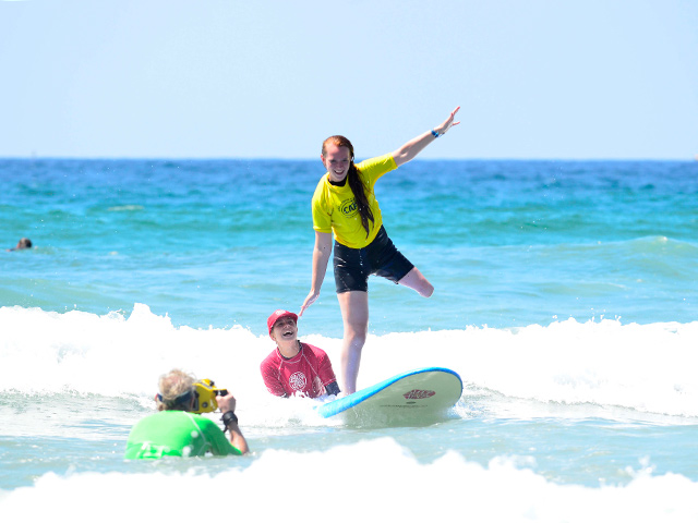 Former Football Player S Charity Funds Surfers With